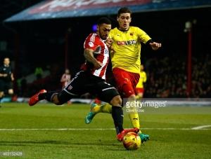 Striker Andre Gray beats the Watford defence